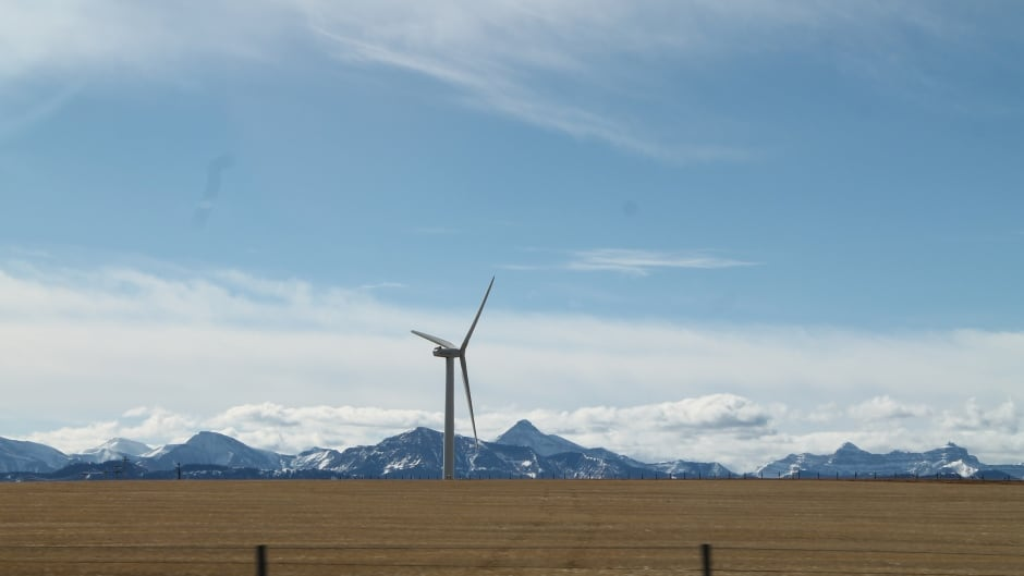 A wind turbine, with the Rocky Mountains behind, near Pincher Creek, in southern Alberta.