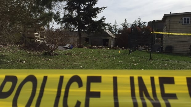 Police tape surrounds this heritage home in Tsawwassen where dozens of officers are searching.
