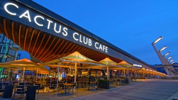 A claim that a client inappropriately touched a server at the Coal Harbour Cactus Club Cafe has resulted in the resignation of a senior Ledcor executive.