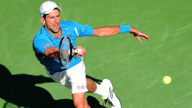 World No. 1 Novak Djokovic returns a forehand in a straight sets win over Jo-Wilfried Tsonga at the 2016 BNP Paribas Open in Indian Wells, Calif., on Friday. Djokovic dominated both tiebreakers to prevail 7-6 (2), 7-6 (2) and reach the semifinals, where he will meet Rafael Nadal in a matchup of players who have won a combined seven titles in the California desert. Nadal defeated Kei Nishikori 6-4, 6-3, connecting on 89 per cent of his first serves.