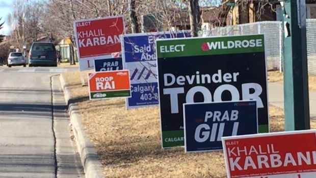 Election signs line the road outside Abbeydale School in northeast Calgary. Voters head to the polls on March 22 to replace the late Manmeet Bhullar.