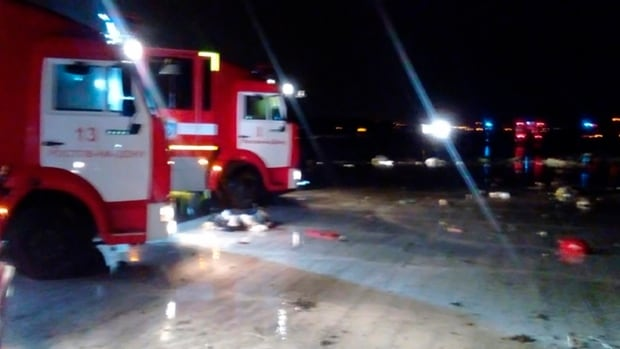 Emergency trucks are seen near the area where a passenger plane from Dubai crashed at the Rostov-on-Don airport.
