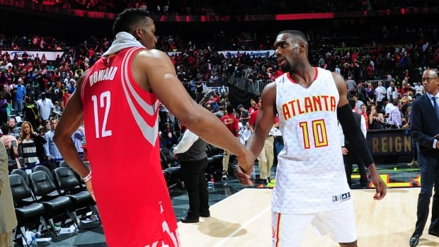 There's no word on whether Tim Hardaway Jr. of the Atlanta Hawks, right, was able to release his hand after shaking it with Dwight Howard of the Houston Rockets on Saturday night at Philips Center in Atlanta, Georgia.