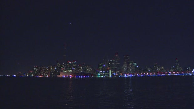 Many lights still flickered but Toronto's cityscape was dimmer than usual during Earth Hour 2016.