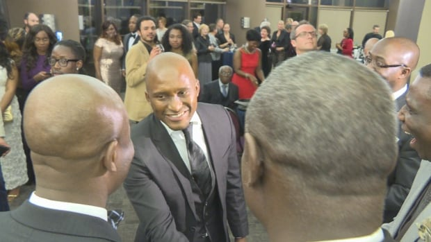 Zondwa Mandela, grandson of former South African president Nelson Mandela, shakes hands at the Canadian Museum of History on March 19, 2016, during the Black History Month Gala and Mandela Legacy Awards.