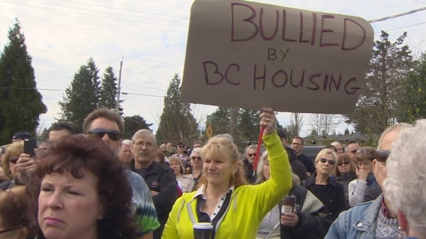 Maple Ridge residents gathered to protest a plan to convert the Quality Inn Hotel into a homeless shelter.