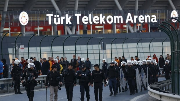 Riot police walk outside the Turk Telekom Arena in Istanbul Sunday. A soccer match between Turkish rivals Fenerbahce and Galatasaray was postponed after Istanbul's governor's office said 'serious intelligence was obtained' about a potential security threat.