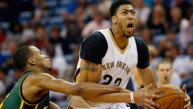 New Orleans Pelicans forward Anthony Davis, right, averaged 24.3 points and 10.3 rebounds in 61 games this season.