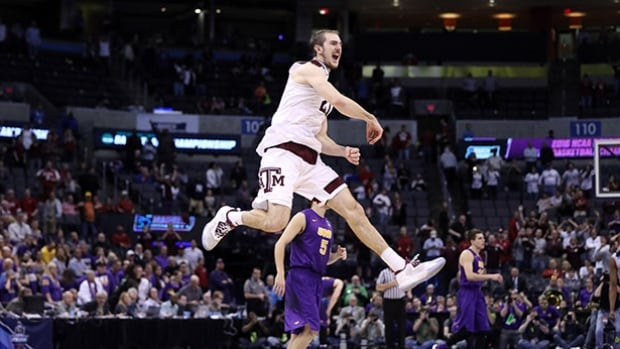 Alex Caruso of the Texas A&M Aggies celebrates after defeating the Northern Iowa Panthers in double overtime during the second round of the 2016 NCAA Men's Basketball Tournament at Chesapeake Energy Arena on Sunday in Oklahoma City, Oklahoma.