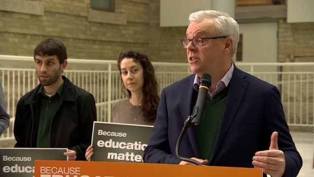 NDP Leader Greg Selinger speaks to reporters and students Monday morning at the University of Manitoba Bannatyne Campus.