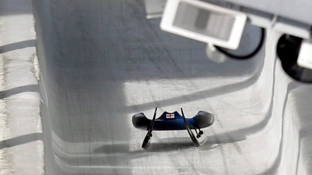 In this Friday, Feb. 12, 2010 file photo, the sled belonging to Nodar Kumaritashvili of Georgia sits empty on the track just after he crashed during a training run for the men's singles luge at the Vancouver 2010 Olympics in Whistler, B.C.