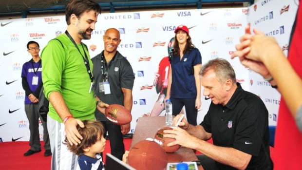 Hall of Fame quarterback Joe Montana signs autographs in China.  The NFL is considering playing a regular season game in 2018.