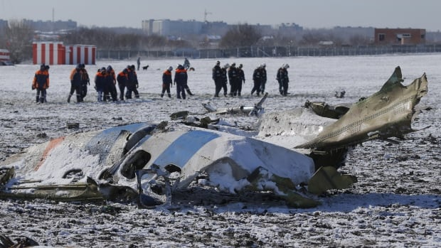Emergency workers at the crash site of Flight FZ981, operated by Dubai-based budget carrier Flydubai, at the airport of Rostov-On-Don, Russia.