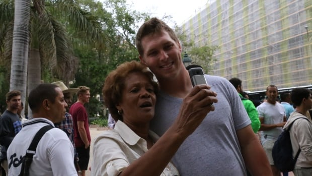 Outfielder Corey Dickerson poses for a selfie Monday morning as the Tampa Bay Rays spent about 20 minutes at Havana's Parque Central to see the 'Hot Corner,' where impassioned Cuban baseball fans go to debate furiously about baseball.