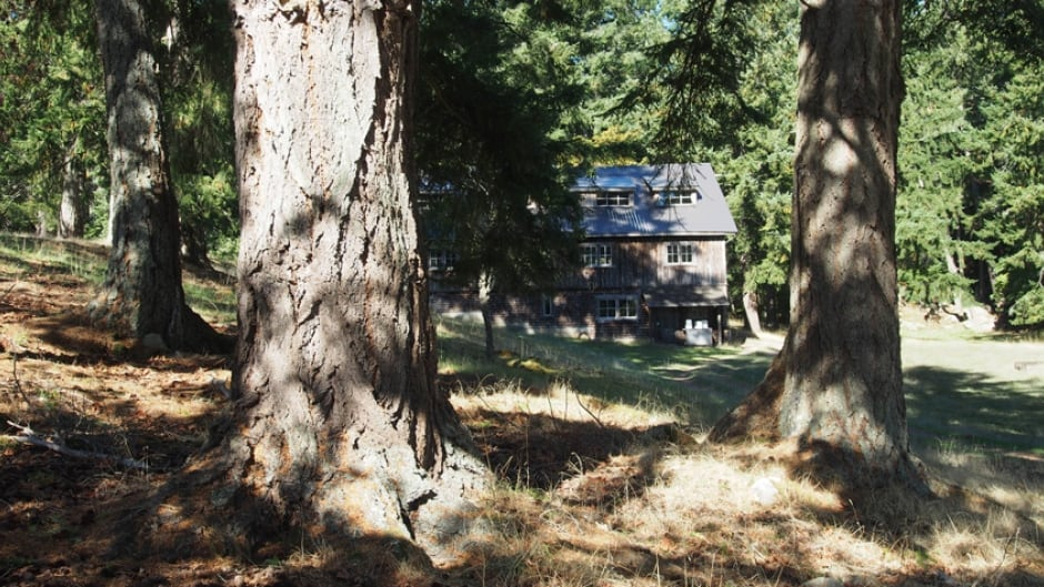 The dormitory and grounds of Brother XII's old farmstead on De Courcy Island, BC.