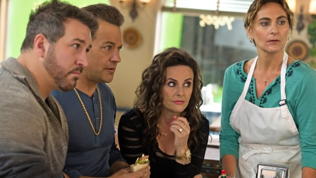 This image, released by Universal Pictures shows, from left, Joey Fatone, Louis Mandylor, Gia Carides and Stavroula Logothettis in a scene from My Big Fat Greek Wedding 2.