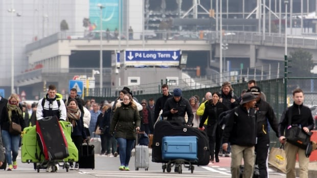 BRUSSELS, BELGIUM - MARCH 22:  Passengers are evacuated from Zaventem Bruxelles International Airport after a terrorist attack on March 22, 2016 in Brussels, Belgium. At least 13 people are though to have been killed after Brussels airport was hit by two explosions whilst a Metro station was also targeted. The attacks come just days after a key suspect in the Paris attacks, Salah Abdeslam, was captured in Brussels.