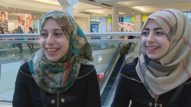 Sisters Waed and Islam Al-Abbas are adjusting to life in Canada, with the help of a Canadian mentor named Rita Koujian.