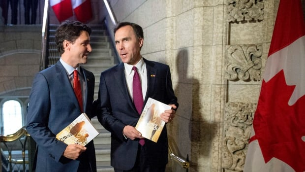 Prime Minister Justin Trudeau speaks with Minister of Finance Bill Morneau as he arrives to table the budget on Parliament Hill, Tuesday. Do you think the Liberals' bigger spending is the route to a stronger economy?
