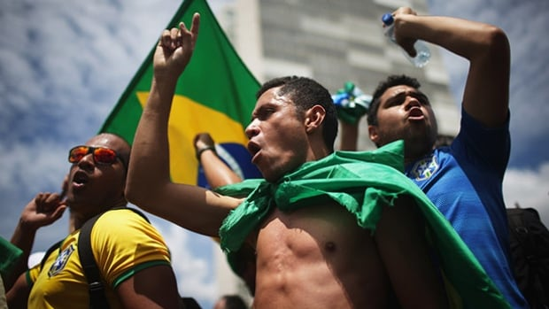 Anti-government demonstrators chant with Brazilian flags outside the National Congress building during demonstrations on March 17 in Brasilia.