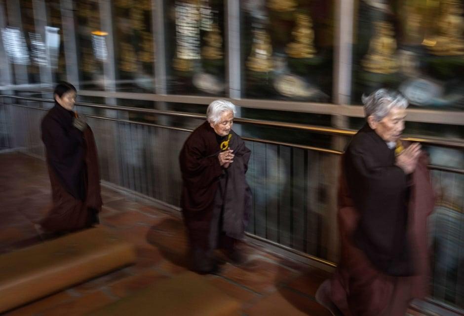 China elderly nursing home Buddhist temple prayers