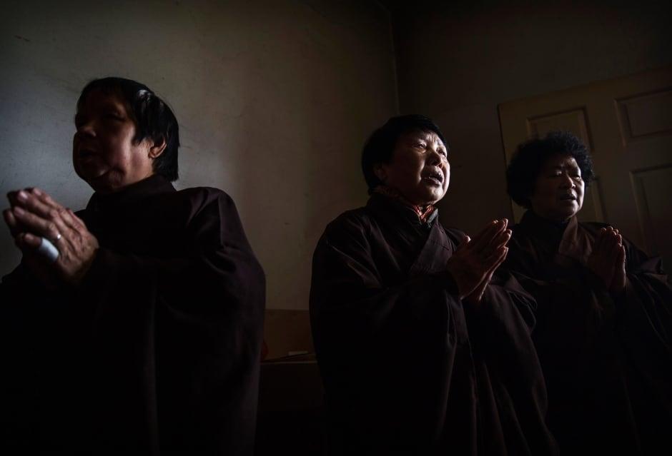 China elderly nursing home Buddhist temple residents wear robes