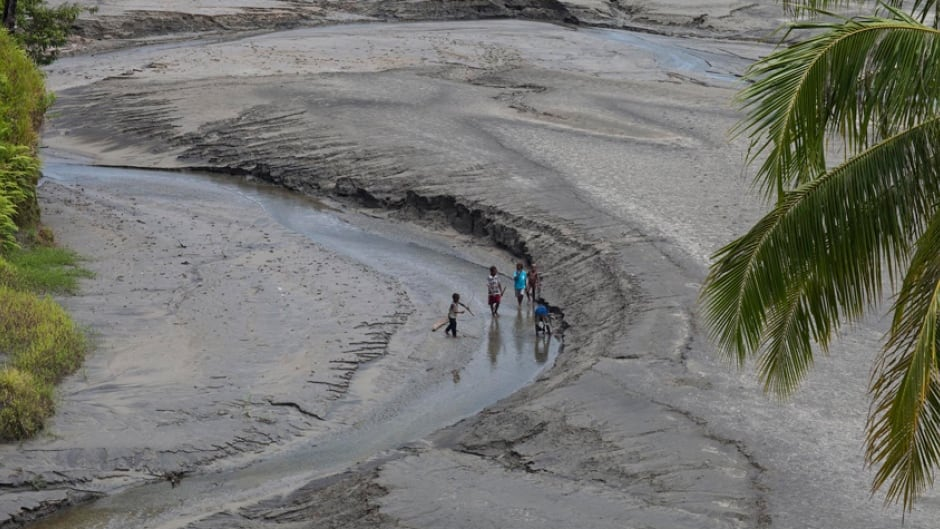 Children playing in tailings downstream from the Ok Tedi Mine in Papua New Guinea, 2009.