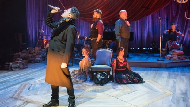 Alessandro Juliani rocks out as the charismatic titular character Evgeni Onegin, with other members of the cast of Onegin behind him.