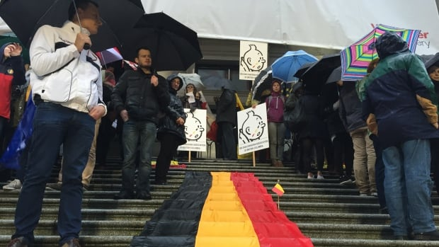 Mourners gathered outside the Vancouver Art Gallery Wednesday evening to show support for the victims of the Brussels airport and metro bombings.