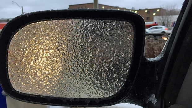 Freezing rain left roads, treets, sidewalks and vehicle mirrors covered in ice.