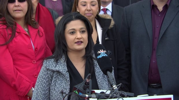 Manitoba Liberal Leader Rana Bokhari speaks to reporters in front of the provincial legislature in Winnipeg on Thursday.