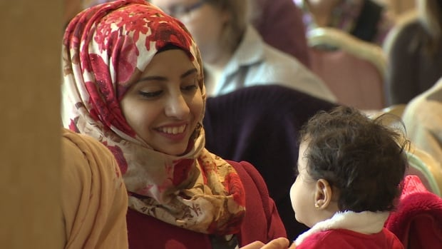 Politicians, volunteers and new Syrian immigrants gathered Thursday morning to celebrate the end of the first refugee settlement phase.