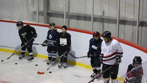 Kimmirut hockey players — from left: Qaqqassiq Ikkidluak, Michael Manning, Iola Michael, Ryan Akpik, Joannassie Qimirpik and Levi Ikkidluak — work on their skills at the hamlet's arena.