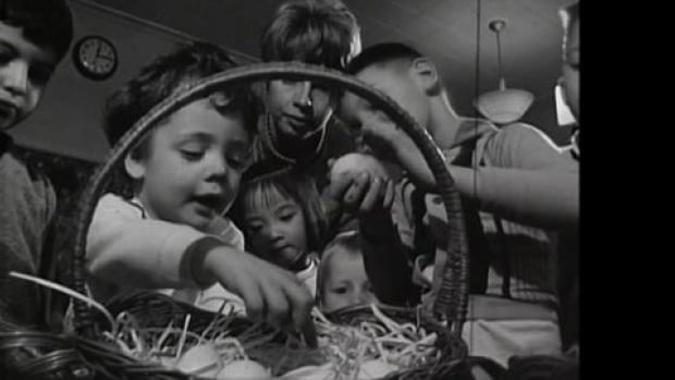 Children inspect Easter eggs in Ottawa in the 1960s.