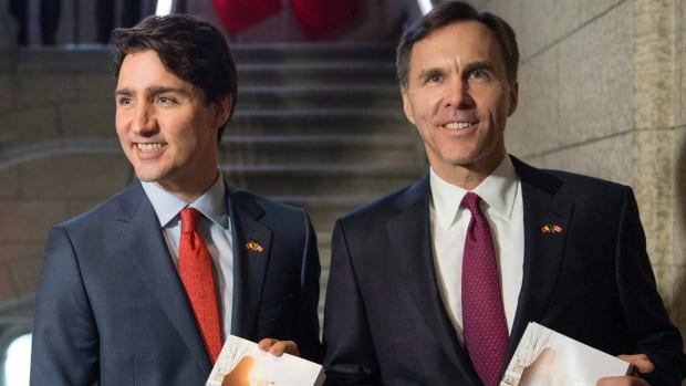 Prime Minister Justin Trudeau, left, poses with Minister of Finance Bill Morneau as he arrives to table the budget on Parliament Hill March 22, 2016 in Ottawa.  The drafted legislation is 179 pages.