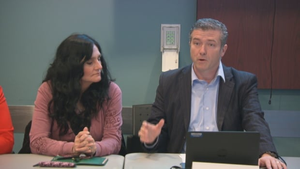City Councillor Tim Tierney leads a community meeting to discuss recent violence on Jasmine Crescent in Ottawa's Gloucester neighbourhood. Tierney is joined by Laurie Beaudoin, who lost her son to violence on the street nearly a year ago. (CBC)