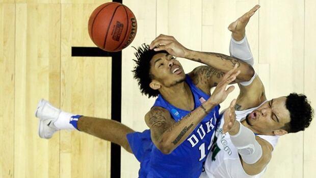 Oregon's Dillon Brooks, right, fouls Duke guard Brandon Ingram during their NCAA men's basketball tournament game on Thursday night. Brooks scored a team-high 19 points in the Ducks' win.
