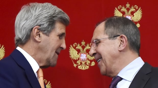 U.S. Secretary of State John Kerry, left, speaks with Russian Foreign Minister Sergei Lavrov during a news conference at the Kremlin in Moscow on Thursday.