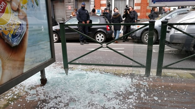 Broken glass from a tramway stop shelter after shots were fired during a police search in the Brussels borough of Schaerbeek on Friday.
