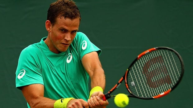 Vasek Pospisil returns to Joao Sousa of Portugal in the Miami Open at Crandon Park Tennis Center on Friday in Key Biscayne, Fla.
