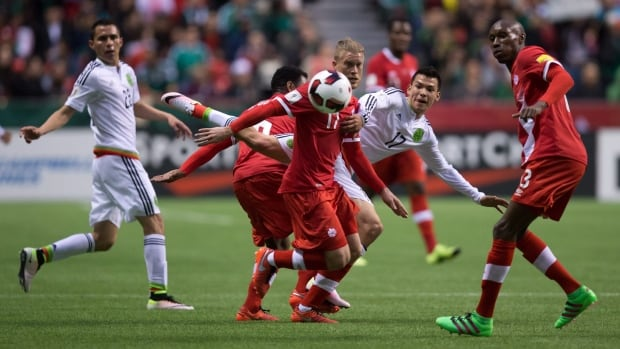 Canada's Marcel De Jong, centre, and Mexico's Hirving Lozano, centre right, vie for the ball during first half FIFA World Cup qualifying soccer action in Vancouver, B.C., on Friday March 25, 2016. THE CANADIAN PRESS/Darryl Dyck