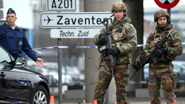 Belgian troops and police control a road leading to Zaventem airport following last Tuesday's airport bombings in Brussels. Eleven people were killed in suicide explosions at the airport on March 22, while 20 people died in a bombing attack on a subway train in the city on the same day.