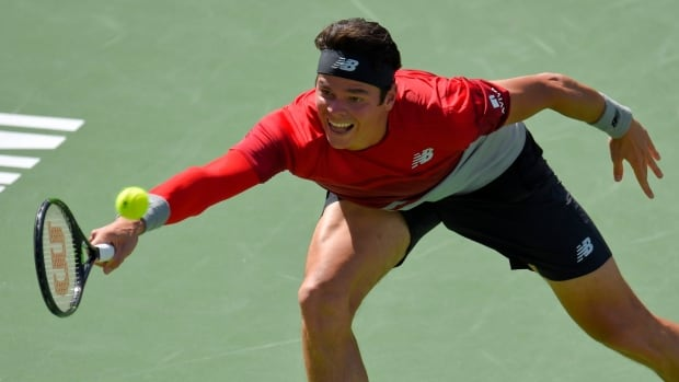 Milos Raonic, shown in this file photo, defeated American Denis Kudla on Saturday to advance at the Miami Open.