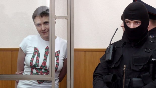 Ukrainian military pilot Nadiya Savchenko looks out from a defendants' cage as she attends the verdict announcement at a court in the southern Russian town of Donetsk, on March 21, 2016.