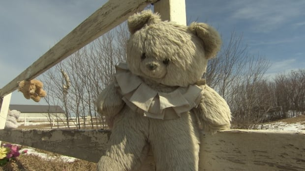 Children's toys are attached to a fence around a cemetery site where research is taking place to learn more about graves associated with the old Regina Indian Industrial School.