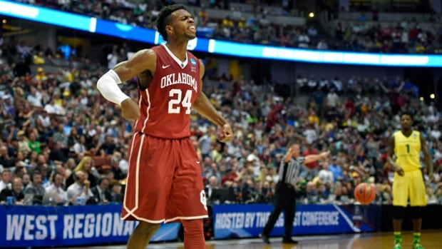 Oklahoma guard Buddy Hield celebrates after scoring during the first half against Oregon in the regional finals of the NCAA men's basketball tournament on Saturday in Anaheim, Calif.