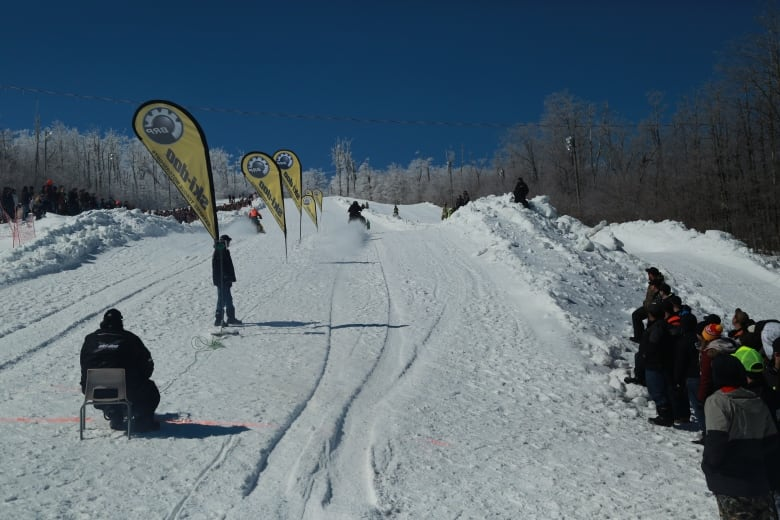 Snowmobiles race up Crabbe Mountain at new event   CBC News