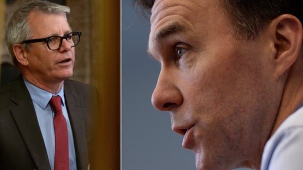 Toronto MP Adam Vaughan, left, and his Liberal colleague, Finance Minister Bill Morneau, engaged in what looked to be a tense conversation in the House of Commons a couple days after Morneau tabled his budget, although Vaughan denies that characterization.