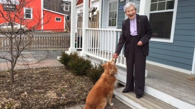 Rev. Barbara Minard and her dog Basil.