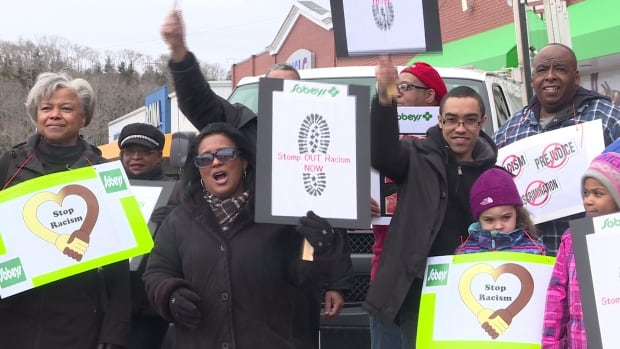 Dozens of people sang songs and spoke to customers about racism outside the Sobeys store.